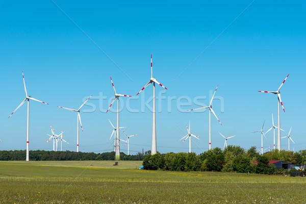 Wind energy plant on a sunny day Stock photo © elxeneize