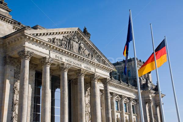 Reichstag with german flag Stock photo © elxeneize