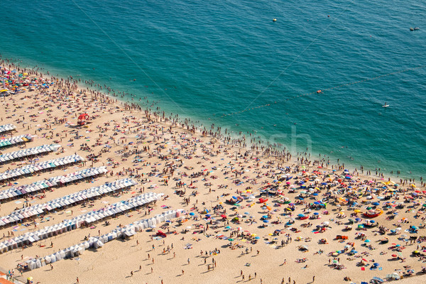 Crowded beach in Nazare Stock photo © elxeneize