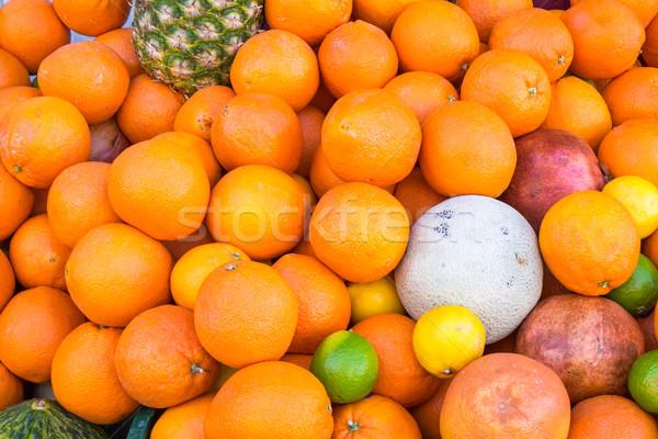Portakal diğer meyve satış pazar mango Stok fotoğraf © elxeneize