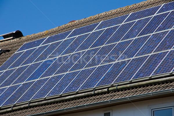 Zonne dak blauwe hemel energie macht elektriciteit Stockfoto © elxeneize