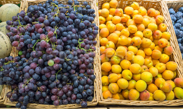 Grapes and yellow plums  Stock photo © elxeneize