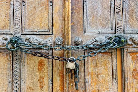 Locked wooden door Stock photo © elxeneize