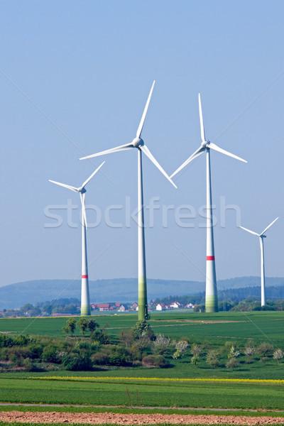 Four windwheels in the fields Stock photo © elxeneize