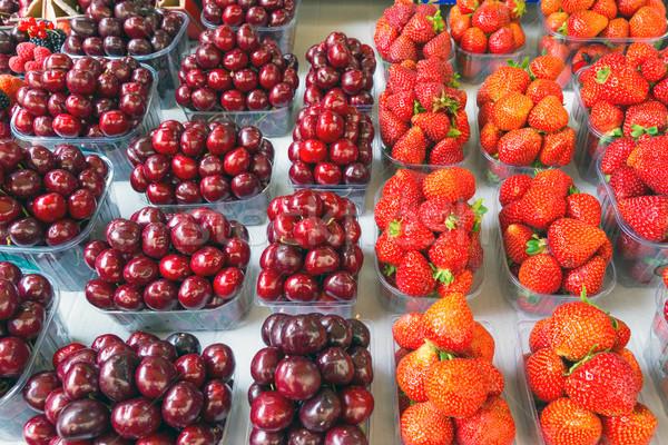 Cherry and strawberry fruitbowles Stock photo © elxeneize