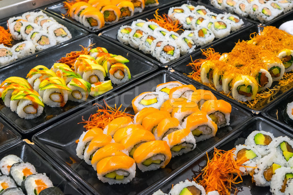 Great variety of sushi rolls Stock photo © elxeneize