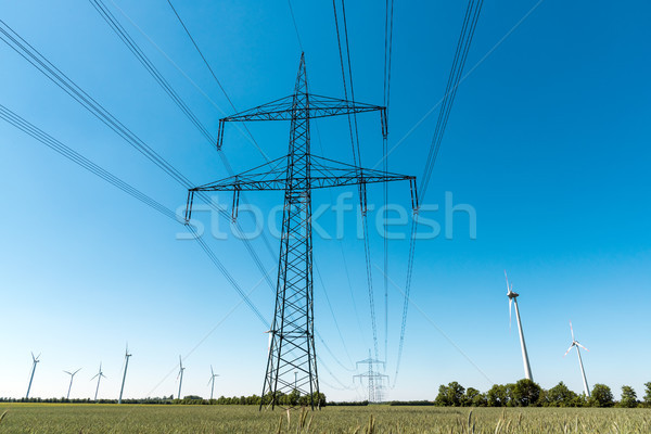 Electric pylons and  a power transmission line Stock photo © elxeneize