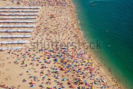 Lots of people at the beach Stock photo © elxeneize