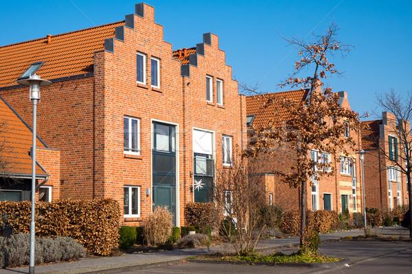 New houses with red bricks Stock photo © elxeneize