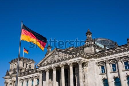 Zászlók híres Berlin égbolt épület kék Stock fotó © elxeneize