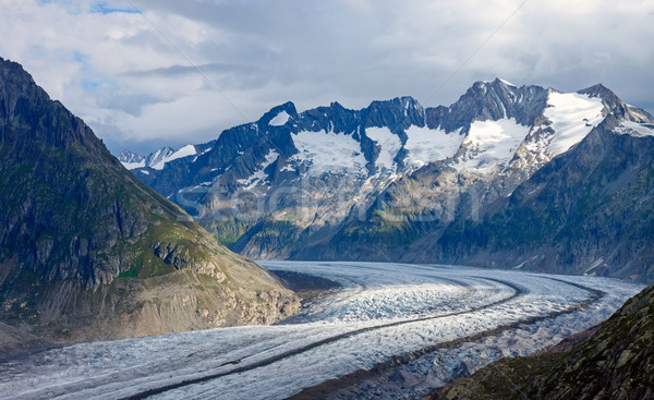 Cloudy day in the alps Stock photo © elxeneize