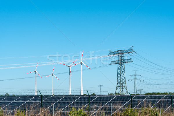 Renewable energy and transmission lines Stock photo © elxeneize
