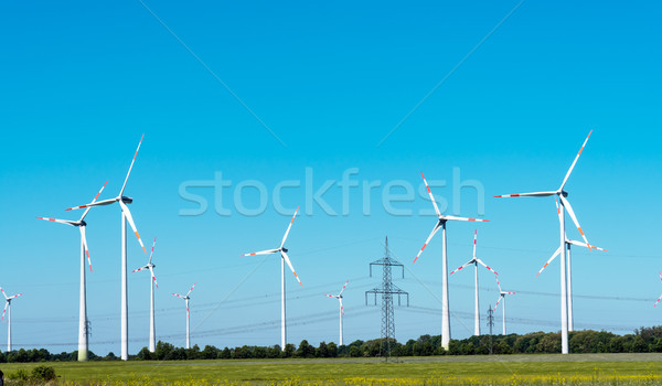 Windwheels and overhead cables in Germany Stock photo © elxeneize