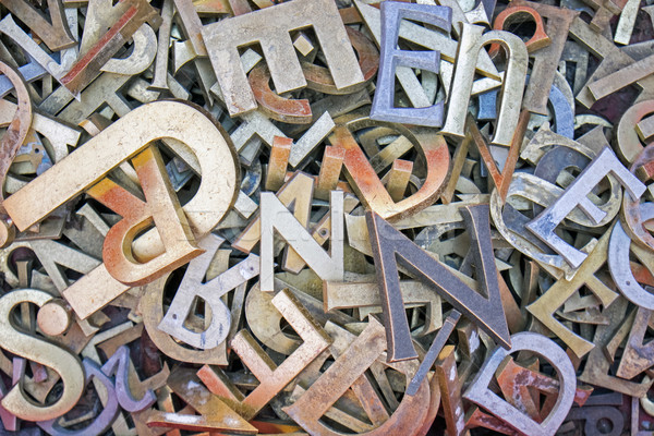 Pile of different iron letters  Stock photo © elxeneize