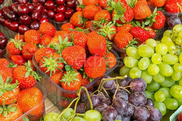 Strawberries, cherries and grapes Stock photo © elxeneize