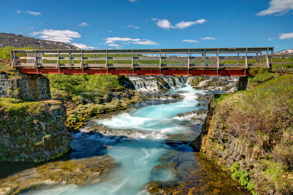 Bruarfoss waterfall with footbridge Stock photo © elxeneize
