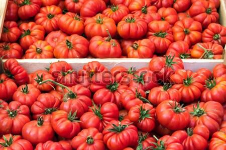 Ripped sicilian tomatoes for sale Stock photo © elxeneize