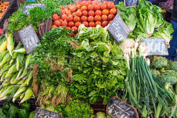 Lettuce, corncob and tomatoes for sale at a market Stock photo © elxeneize
