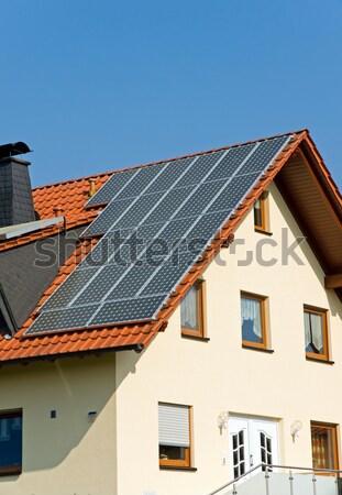 Old barn with solar cells Stock photo © elxeneize