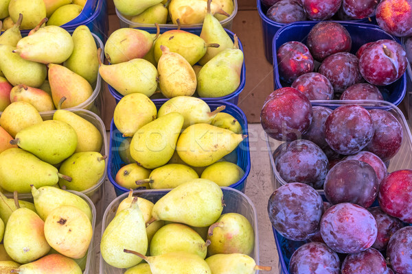 Plums and pears for sale Stock photo © elxeneize