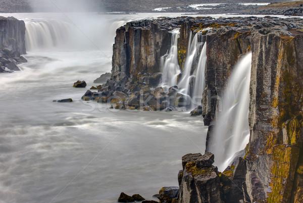 Cachoeira Islândia norte viajar corrida rocha Foto stock © elxeneize