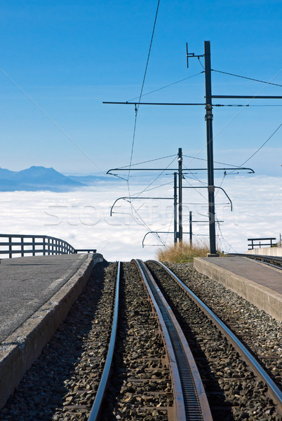 Railway over the clouds Stock photo © elxeneize