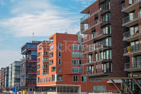 Modern épületek égbolt épület építkezés kék Stock fotó © elxeneize