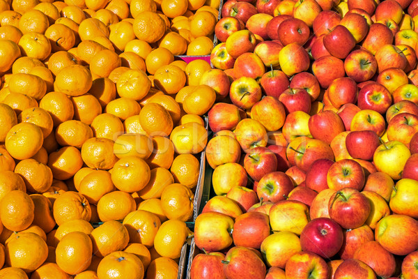 Clementines and apples for sale Stock photo © elxeneize