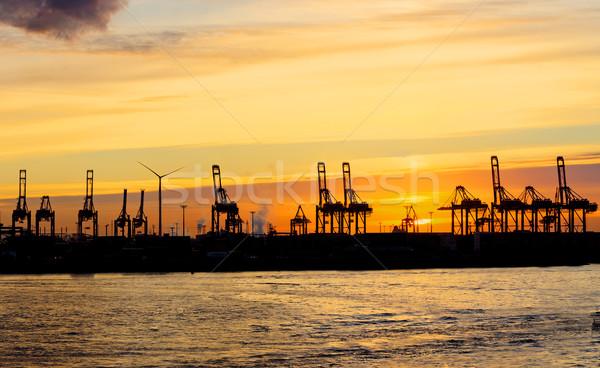 Zonsondergang hamburg haven container water straat Stockfoto © elxeneize