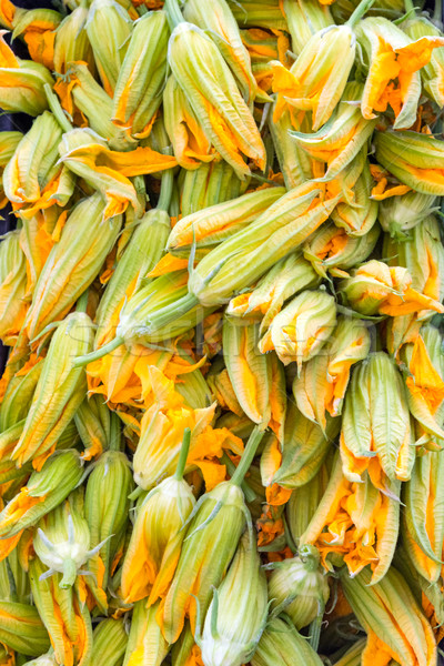 Zucchini flowers for sale  Stock photo © elxeneize