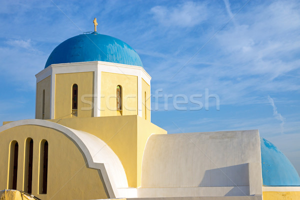 Yellow church with blue cupola Stock photo © elxeneize