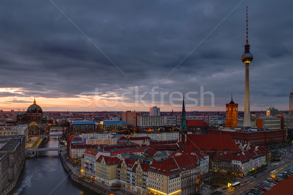 Központ Berlin hajnal torony felhők város Stock fotó © elxeneize