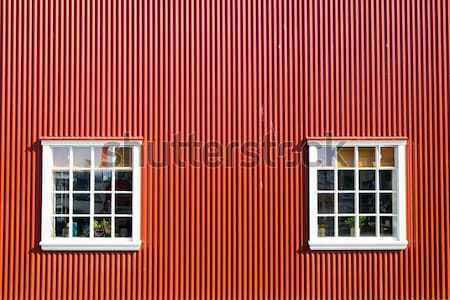 Red wall and two windows Stock photo © elxeneize