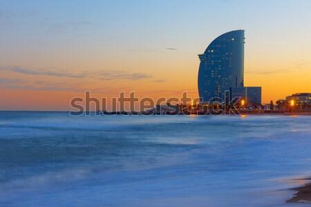 Tengerpart Barcelona naplemente modern felhőkarcoló égbolt Stock fotó © elxeneize