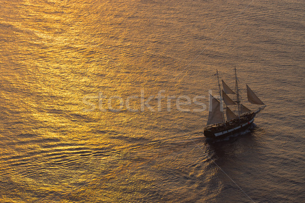Ship sailing at sunset Stock photo © elxeneize