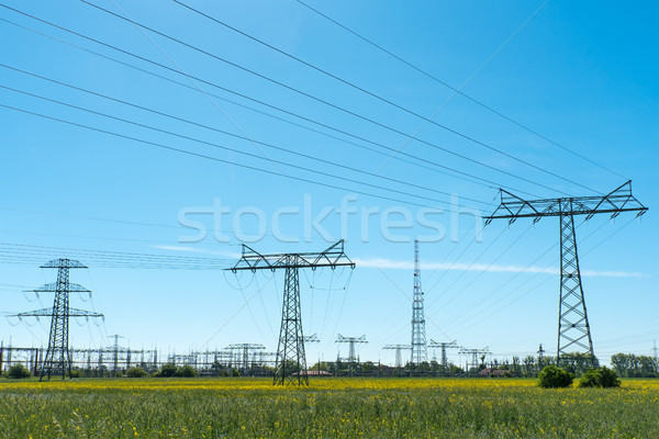 Relay station and power transmission lines seen in Germany Stock photo © elxeneize