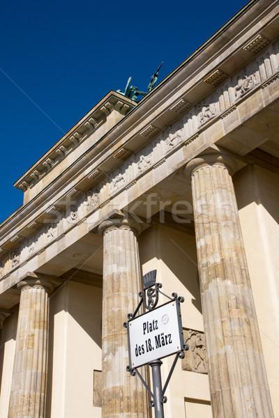 Brandenburger Tor and street sign Stock photo © elxeneize