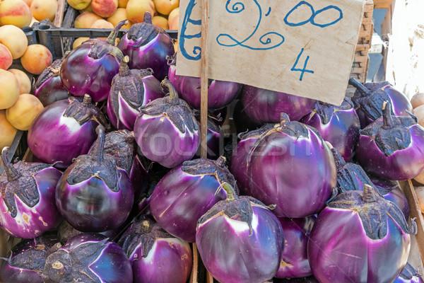 Fresh round eggplant at a market Stock photo © elxeneize