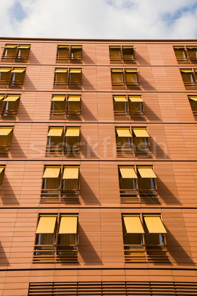 Orange apartment building Stock photo © elxeneize