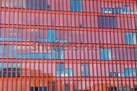 Czerwony fasada biurowiec nowoczesne biuro miasta Zdjęcia stock © elxeneize