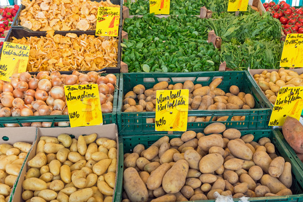 Potatoes and other vegetables at a market Stock photo © elxeneize