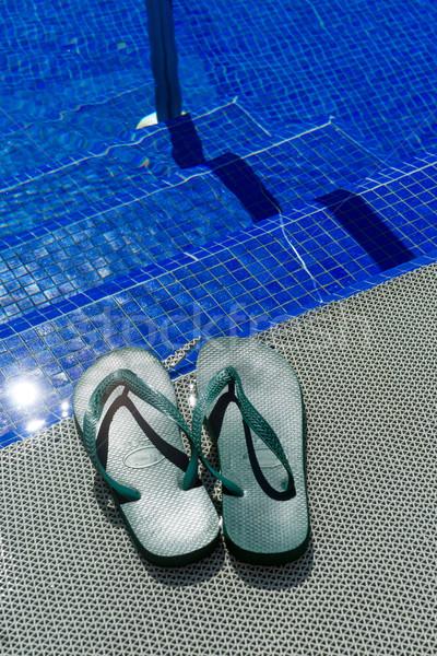 Green flip-flops at a pool Stock photo © elxeneize