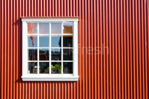 Red wall and white window Stock photo © elxeneize