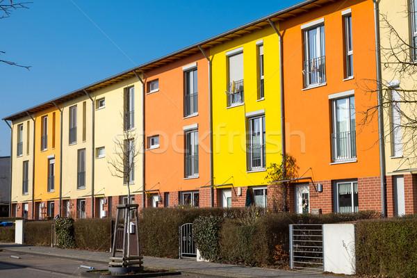 Színes lakásügy Berlin Németország égbolt otthon Stock fotó © elxeneize