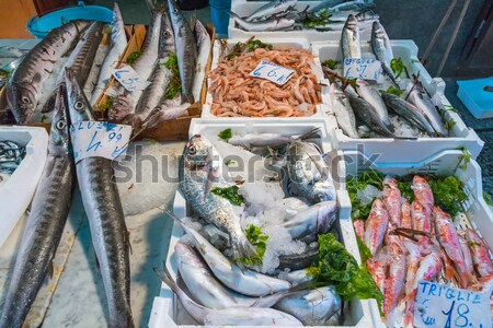 Market stand with fish and seafood Stock photo © elxeneize