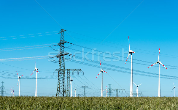 Wind energy and power transmission lines in Germany Stock photo © elxeneize