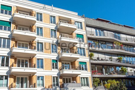 Colourful modern townhouses Stock photo © elxeneize