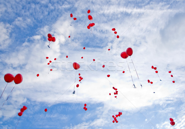 Red balloons flying to the sky Stock photo © elxeneize