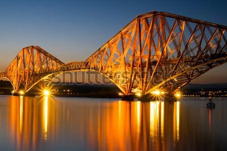 Rail brug verlicht dawn weg gebouw Stockfoto © elxeneize