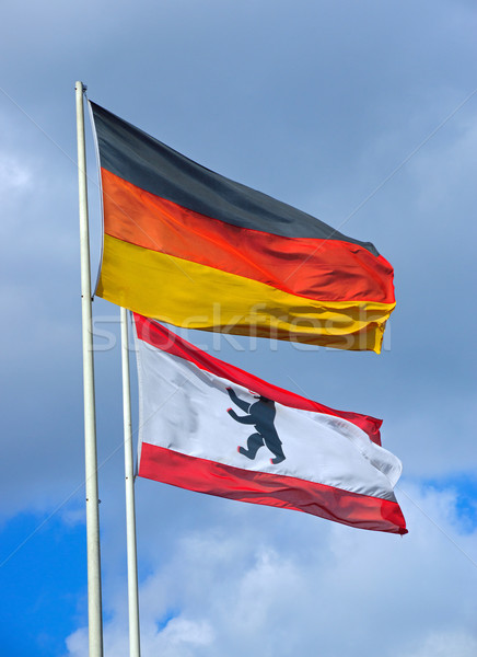 The German and the Berlin flag Stock photo © elxeneize